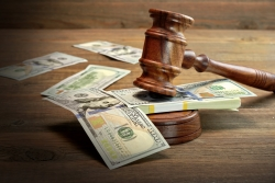 gavel slamming on a stack of money to decide on alimony in new york